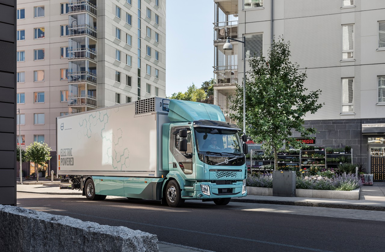 An electric truck drives through the city