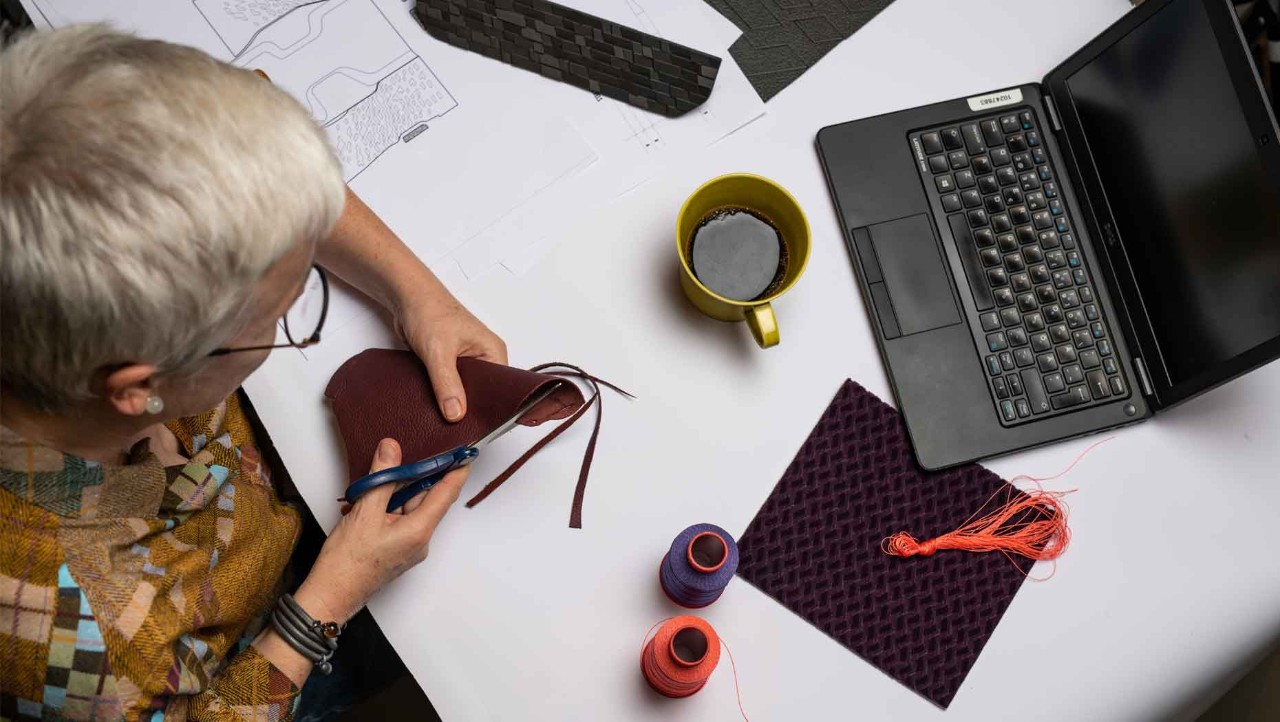 Aerial view of Carina Byström cutting a leather sample